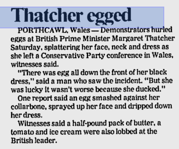 James O Jenkins Thatcher's Funeral  'Mrs Thatcher tries to wipe off the mess after an egg hit her at Porthcawl'. 23rd June 1984. Image © Western Mail